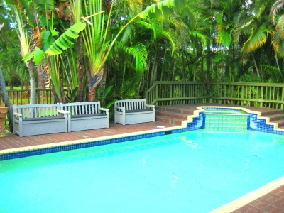 Relax around lushly landscaped pool and patio or soak in the hot tub...great unwinding spot!