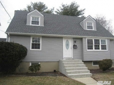 Independence Begins By Owning Your Own Home...Rear Dorm.Cape In Prime Village Loc. 4 beds 2 baths $405,000