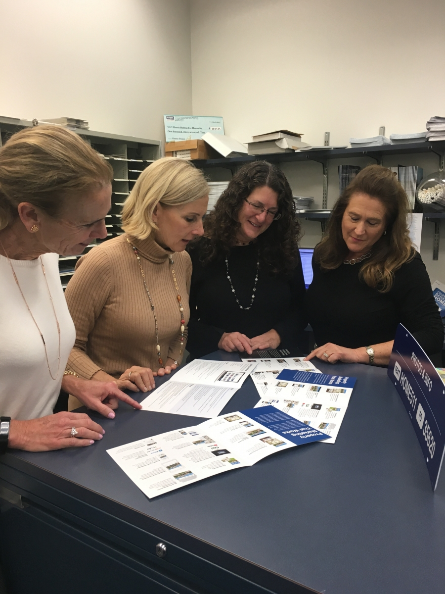 (left to right) Mendham Coldwell Banker Residential Brokerage agents Reina Graziano, Pam Tishman, Susan Prisco and Ellen Gordon review Listing Concierge brochures.